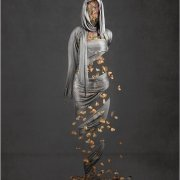 award winning figurative art featuring silver silk and falling autumn leaves revealing the female figure