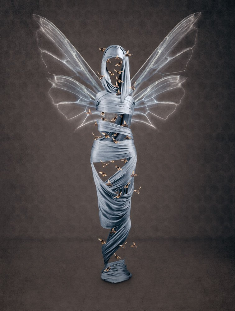 figurative art showing a body draped in blue silk scarves with bees and wings