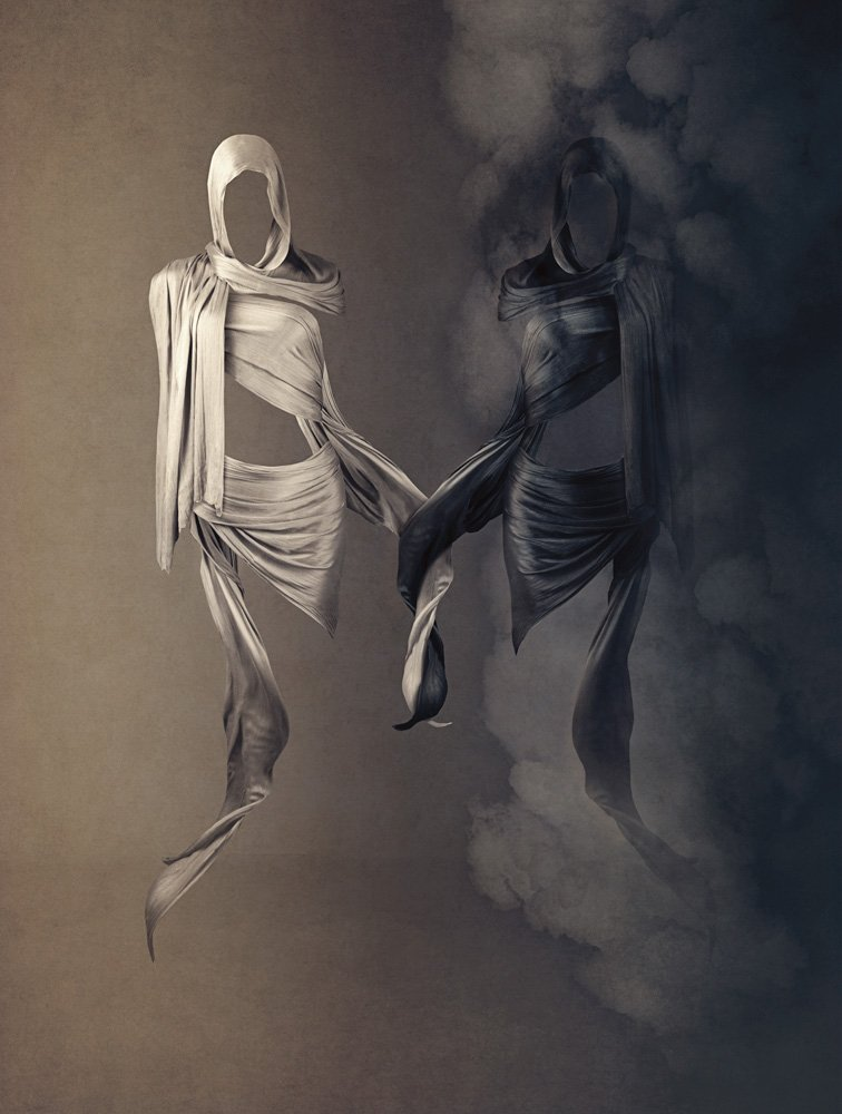 Two figures represented using draped scarves holding hands in self compassion