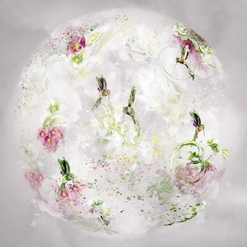 floral sphere filled with flowers and humming birds