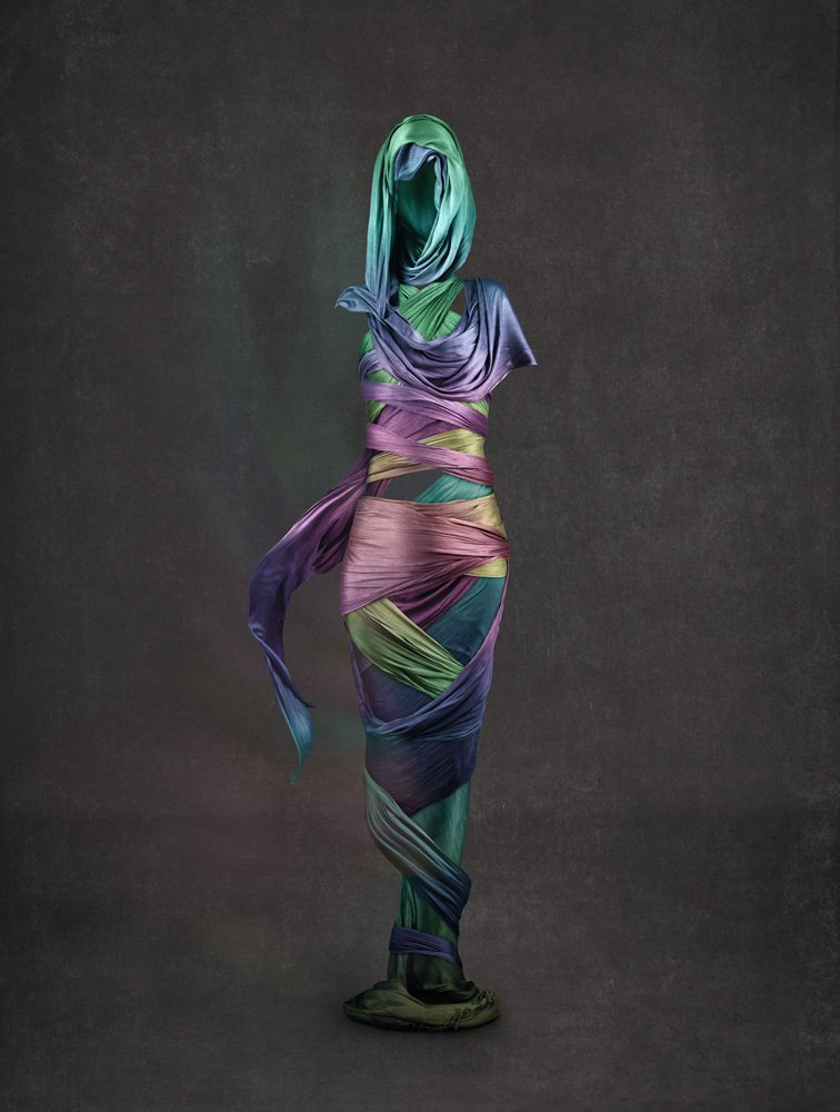 figurative photo art with a missing body highlighted with draped coloured silk scarves